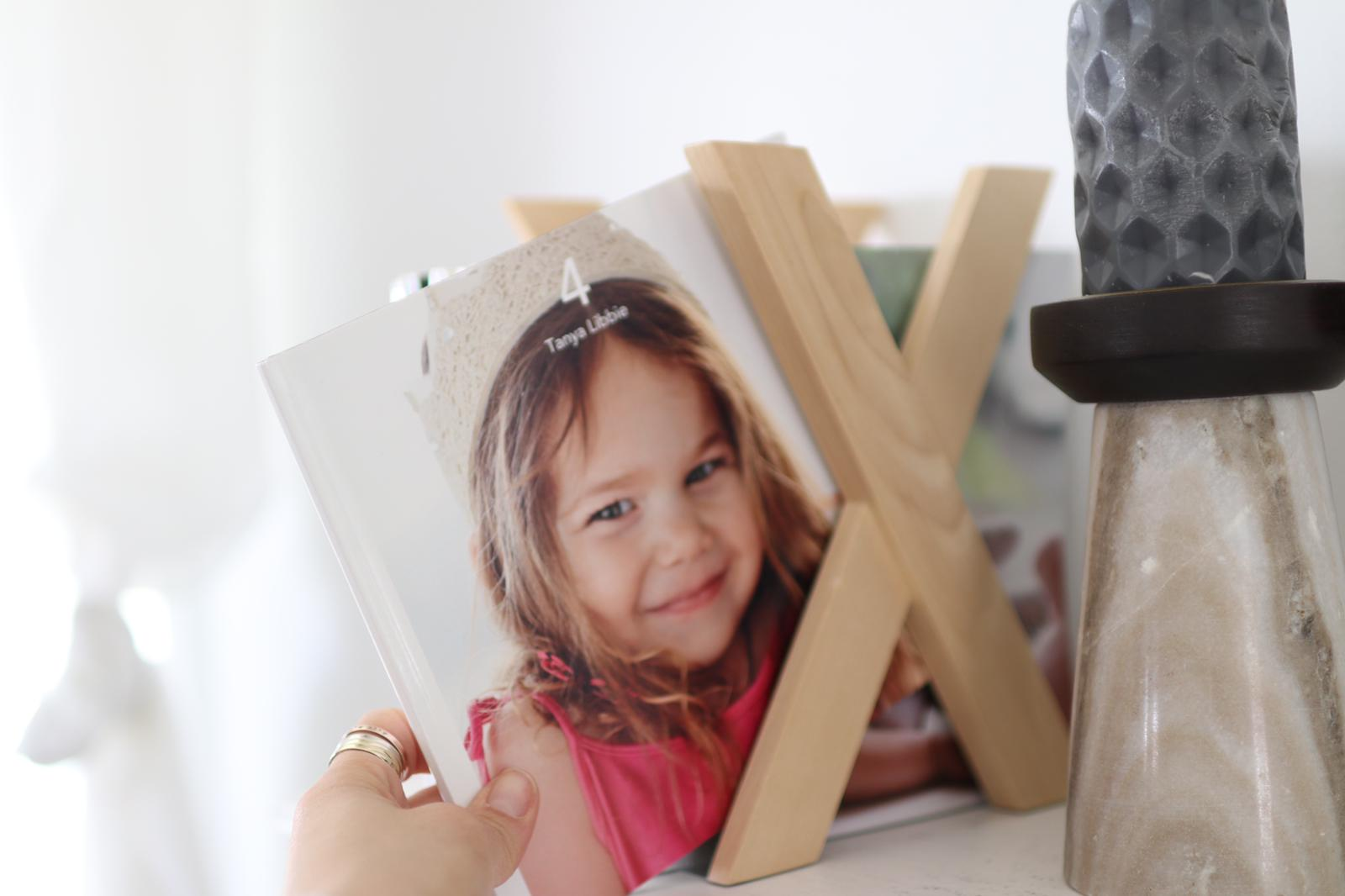 a stack of photo albums that create quality time with family